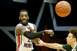 Robert Morris' Lucky Jones passes the ball off against Wagner in the first half Thursday, February 26, 2015 at the Sewall Center.