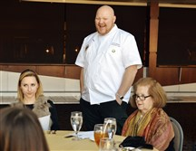Scott Walton, executive chef at Heinz Field, talks with the table of tasters  for the 2015 Ireland Fund benefit at Heinz Field. Seated, from left, are Meg McCabe and Patricia Rooney.
