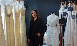 Glitter & Grit bridal boutique owner Erin Szymanski with some of the shop's non-traditional gowns. After nearly five years on Butler Street in Lawrenceville, the shop will merge with its sister store, Luna boutique, in Sewickley.