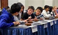 From left, Venkata Daita, Jiwoo Cheon, Jerry Chen and Jiangfeng Chu, students from North Allegheny's Marshall Middle School, discuss an answer Wednesday during the final rounds of the 2015 Southwestern Pennsylvania Science Bowl against Dorseyville Middle School.