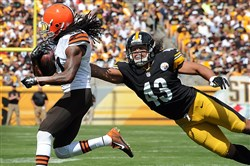 Cleveland's Travis Benjamin breaks away from the grasp of Steelers safety Troy Polamalu during a September game at Heinz Field.