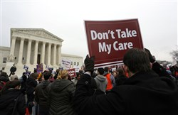 Demonstrators in favor of Obamacare gather at the Supreme Court building in Washington, D.C., on March 4, 2015. The ACA was signed into law by President Barack Obama on March 23, 2010.