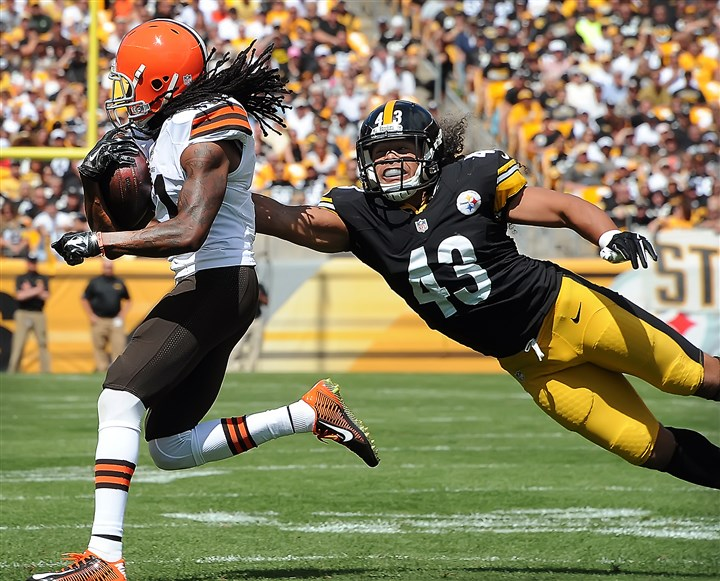 troy0305b-1 Cleveland Browns' Travis Benjamin breaks away from the Steelers' Troy Polamalu during a game at Heinz Field in September 2014.