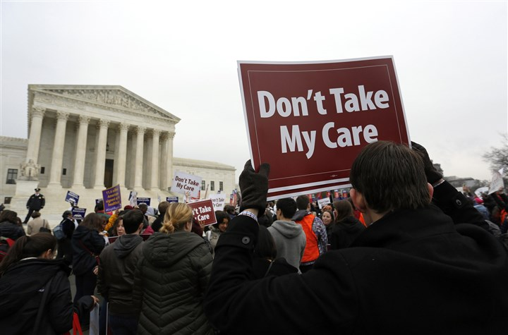 HEALTHCARE Demonstrators in favor of Obamacare gather at the Supreme Court building in Washington, D.C., on March 4, 2015. The ACA was signed into law by President Barack Obama on March 23, 2010.