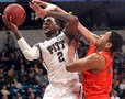 Michael Young led Pitt with a game-high 22 points. He drives against Miami's Omar Sherman in the first half.