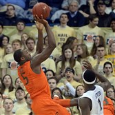 Miami's Davon Reed gets a shot up against Pitt's Jamel Artis in the first half Wednesday, March 4, 2015 at Petersen Events Center.