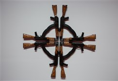 """Cross for the Unforgiven"" by Mel Chin at space gallery on Liberty Avenue Downtown.  Mr. Chin's sculpture consists of cult and welded AK-47s that form a Maltese Cross."