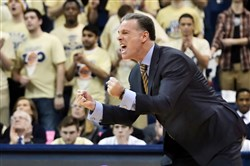 Pitt head Jamie Dixon urges his team on as they take on Miami Wednesday, March 4, 2015 at Petersen Events Center.