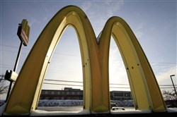 McDonald's Golden Arches logo at a McDonald's restaurant is covered with snow in Robinson Township, Pa.