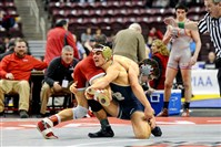 Franklin Regional's Dom Giannangeli, bottom, defeated Cedar Cliff's Steven Ross, 12-2 in the first round of the PIAA Class AAA tournament. Giannangeli won two bouts to advance to the quarterfinals.