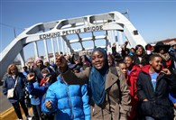 Students walk across the Edmund Pettus Bridge on Friday as they visit historic sites from the Selma-to-Montgomery civil rights march in Selma, Ala. Selma is preparing to commemorate the 50th anniversary of the famed civil rights march that resulted in a violent confrontation with Selma police and Alabama state troopers on the bridge on March 7, 1965.