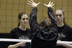 Laura Kelly of Squirrel Hill, left, and Annie Koester of Imperial, right, both 13 and on the 13 Black team, get instructions from Lynda Scahill, center, Director of Coaching at Pittsburgh Elite Junior Olympic Volleyball Club.