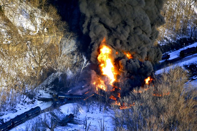Smoke and flames erupt from the scene of a train derailment Thursday near Galena, Ill. A BNSF Railway freight train loaded with crude oil derailed around 1:20 p.m. in a rural area where the Galena River meets the Mississippi, said Jo Daviess County Sheriff's Sgt. Mike Moser.