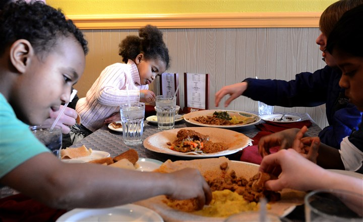 Robert, 8, and Didi Patterson, 4, eat Ethiopian food Robert, 8, and Didi Patterson, 4, eat Ethiopian food with their siblings at Tana in East Liberty. Once a month, the Pattersons join other families who have adopted children from Ethiopia for a get-together at the restaurant.