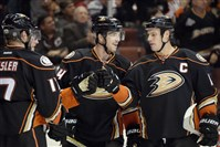 "Former Penguin Simon Despres, center, celebrates an empty-net goal Wednesday with Ryan Getzlaf. Despres said he ""was definitely emotional a bit"" when he learned he was traded to Anaheim."