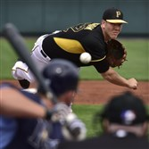 Nick Kingham delivers against the Tampa Bay Rays in March at McKechnie Field in Bradenton, Florida.