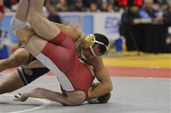 Franklin Regional's Devin Brown pins North Hills junior Gage Curry Saturday to win his third Class AAA PIAA championship.