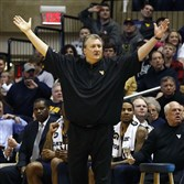 West Virginia coach Bob Huggins reacts from the bench during his team's 81-72 win against Oklahoma State on Saturday.