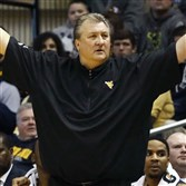 Mountaineers head coach Bob Huggins reacts from the bench against the Oklahoma State in the second half at WVU Coliseum. The Mountaineers won, 81-72.
