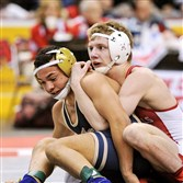 North Hills' Gage Curry, right, battles against Franklin Regional's Devin Brown in the PIAA Class AAA championship match at 113 pounds. Brown won by a 5-3 decision.