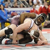Penn Hills' Te'Shan Campbell, right, controls Altoona's D.J. Hollingshead to win the PIAA Class AAA championship at 170 pounds. Campbell took a 4-2 decision.