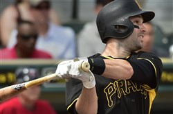 Neil Walker doubles against the Twins last month at McKechnie Field in Bradenton, Florida.