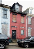 Needs TLC from CDC: 184 34th St., which will now be sold to the Lawrenceville Corp.