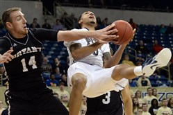 Pitt's Cameron Wright takes a foul from Bryant's Andrew Scocca during a game Monday, February 2, 2015 at the Petersen Events Center.