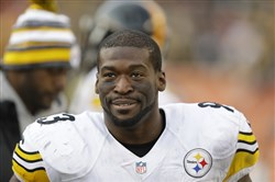 Steelers outside linebacker Jason Worilds smiles on the sidelines during a game against the Bengals in Cincinnati on Dec. 7. Worilds spent five seasons with the Steelers, developing into one of the league's better young outside linebackers. Perched on the edge of a massive payday as a coveted free agent in a thin market, Worilds chose retirement instead.