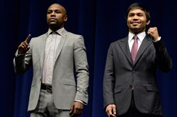 Floyd Mayweather and Manny Pacquiao pose for photographers during a March press conference to announce their upcoming fight.