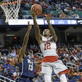 North Carolina State's Anthony Barber shoots over Pitt's Josh Newkirk during the first half of a second round game of the Atlantic Coast Conference tournament in Greensboro, N.C., Wednesday, March 11, 2015.