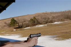 In this March 12, 2015, photo, a man demonstrates his shooting technique at the McDonald Sportsmen's Association.