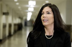 State records show an employee of the attorney general's office received a promotion and $11,000 raise after the publication of an opinion piece she wrote defending Attorney General Kathleen Kane from criticism.