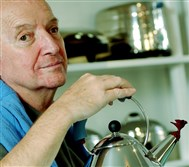 Michael Graves, in 2003, with the Alessi teapot he designed.
