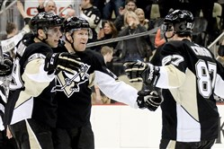 David Perron and Sidney Crosby congratulate Patric Hornqvist on his goal against the Oilers in the third period Thursday, March 12, at Consol Energy Center.