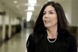 Pennsylvania Attorney General Kathleen Kane walks into the State Supreme Court room in March.
