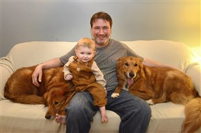 Gunner, a 7--year-old golden retriever-collie mix, left, with his owner, Joseph Karl; Mr. Karl's son, Clancy; and Gunner's brother, Shooter.