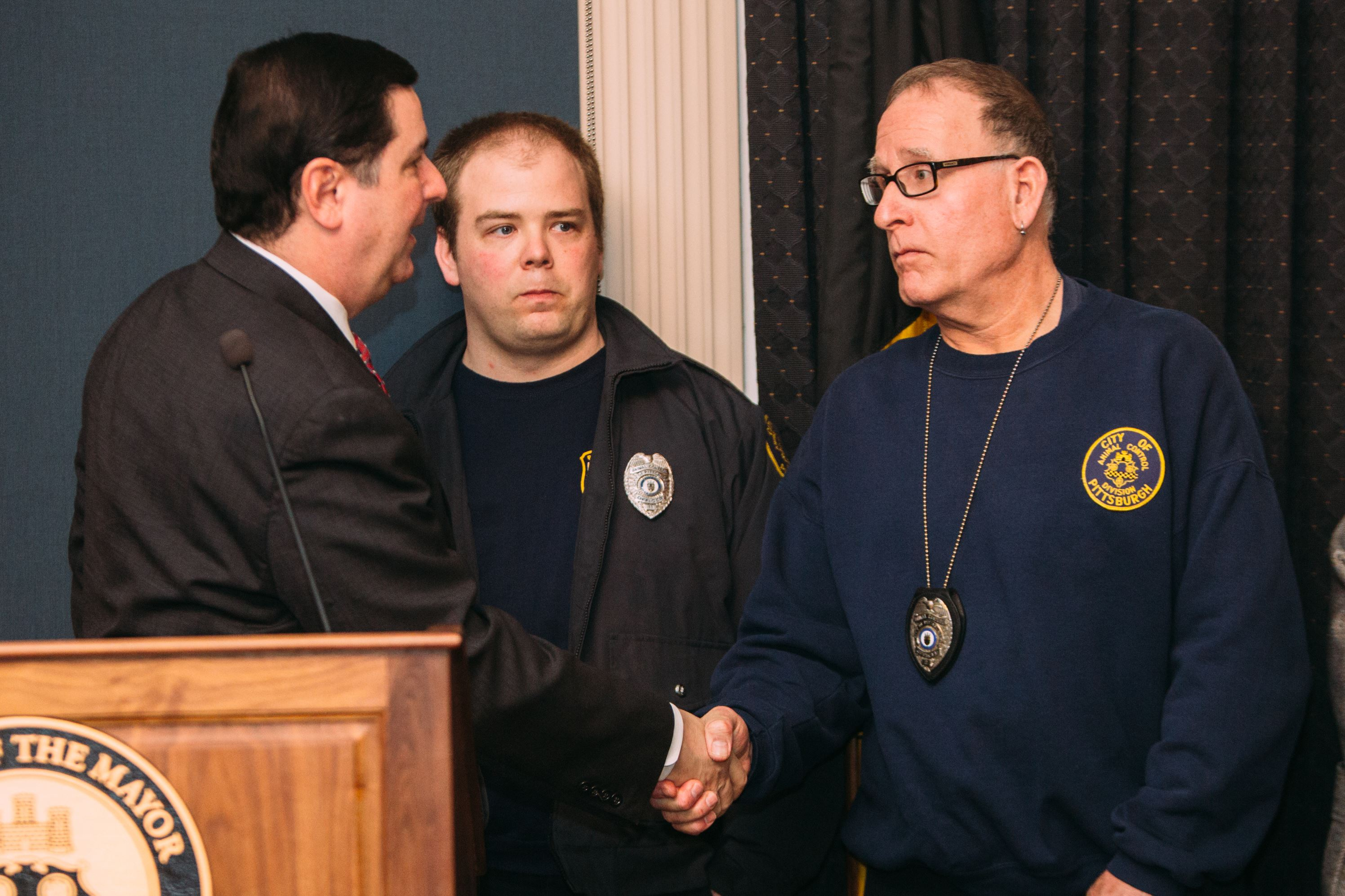 Mayor Bill Peduto greets Jeff Ley, left, and John Lapp Mayor Bill Peduto greets Jeff Ley, left, and John Lapp, both animal control officers, after a news conference to recognize the city's Animal Care and Control department for successfully returning Mr. Karl's dog.