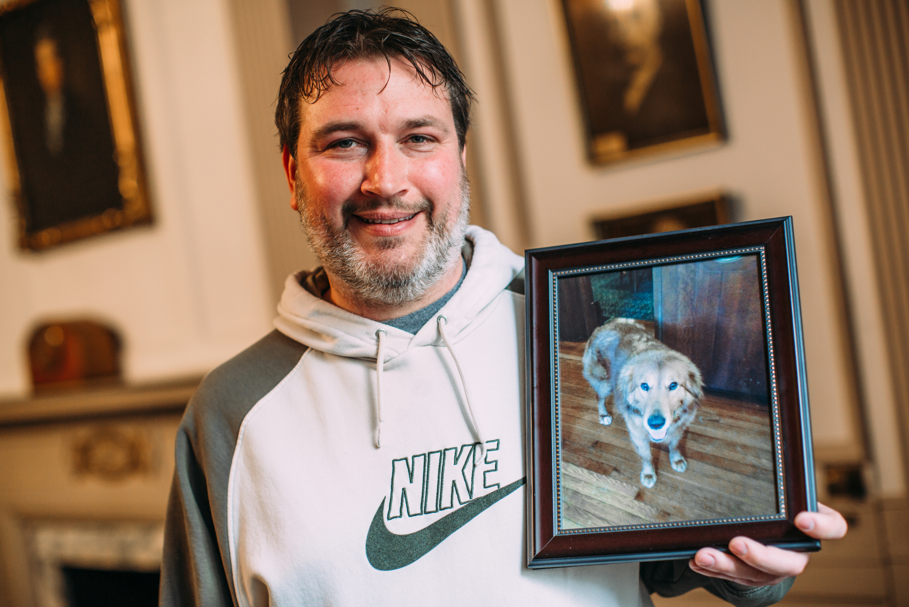 Joseph Karl shows a photo of his dog Gunner, who went missing for 20 months.