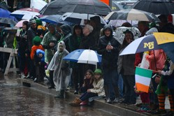 Spectators brave the rain while watching the St. Patrick's Day Parade last weekend Downtown.