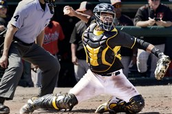 Pirates catcher Elias Diaz throws to second on his knees Sunday against the Orioles at McKechnie Field in Bradenton Fla.