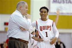 Aliquippa coach Nick Lackovich talks with Jassir Jordan as they play against Redbank Valley in a PIAA quarterfinal game Saturday at Plum.  Aliquippa won the game, 70-36.