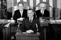 President Lyndon B. Johnson addresses a joint session of Congress on March 15, 1965, urging the passing of the Voting Rights Act. Vice President Hubert Humphrey is at left and House Speaker John McCormack is at right.