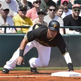 Jose Tabata slides into third base during a spring training game against the Orioles earlier this month.
