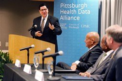 Mayor Bill Peduto speaks Monday at a press conference announcing a new alliance between Pitt, UPMC and CMU.