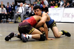 Central Catholic's Vincenzo Joseph defeats Fredy Stroker, from Bettendorf, Iowa, by major decision, 14-4, Sunday in the Dapper Dan Wrestling Classic.