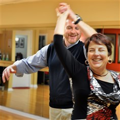 20150311RARhealthdance1 Dance instructor Chris Roth, owner of Steel City Ballroom in Mt. Lebanon, works on a salsa dance with student Becky Stern. Mr. Roth was part of the University of Pittsburgh $14 million to study better ways to prevent lower back pain.