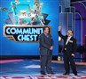 "Host Billy Gardell cheers with contestant, Antonios Karamalegos, of North Carolina as he plays Community Chest in an attempt to win big money on ""Monopoly Millionaires' Club.""."