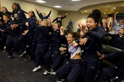 The Pitt women's basketball team celebrates after Monday's announcement that it earned a bid to the NCAA tournament.