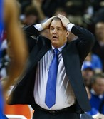 Kentucky head coach John Calipari reacts after a foul in the first half of an NCAA college basketball game against Georgia in Athens, Ga. Two teams took the Wildcats to overtime and six others found a way to keep the final margin within 10 points.